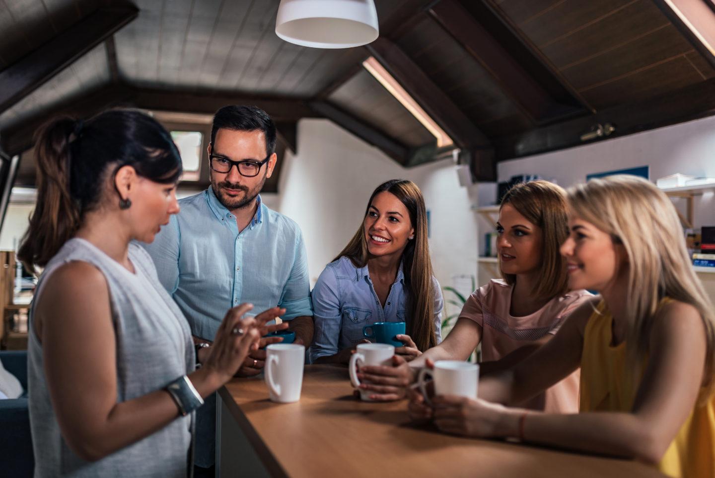 Colleagues on break drinking coffee
